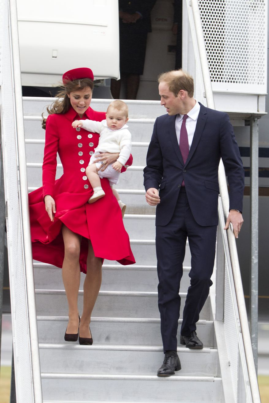 Britain's Prince William and Catherine, Duchess of Cambridge with Prince George arrive for their visit to New Zealand at the International Airport, in Wellington, New Zealand, Monday, April 7, 2014. (AP Photo/SNPA, David Rowland) NEW ZEALAND OUT