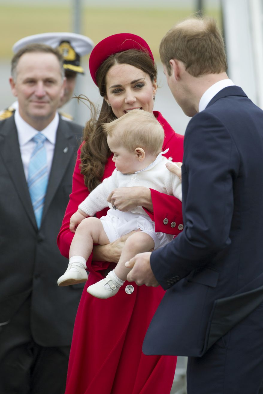 New Zealand's Prime Minister John Key watches as Britain's Prince William and Catherine, Duchess of Cambridge with Prince George arrive for their visit to New Zealand at the International Airport, in Wellington, New Zealand, Monday, April 7, 2014. (AP Photo/SNPA, David Rowland) NEW ZEALAND OUT