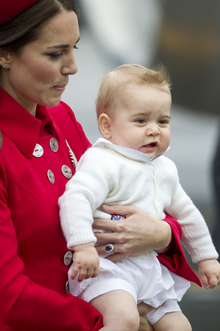 Britain's Catherine, Duchess of Cambridge holds Prince George while arriving for their visit to New Zealand at the International Airport, in Wellington, New Zealand, Monday, April 7, 2014. (AP Photo/SNPA, David Rowland) NEW ZEALAND OUT