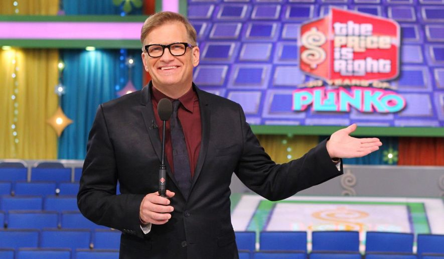 """This 2013 photo released by CBS shows Drew Carey, host of """"The Price is Right,"""" on the set in Los Angeles. (AP Photo/CBS, Cliff Lipson)"""