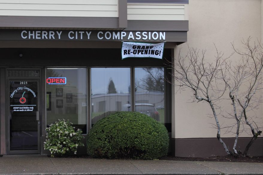 This photo taken Friday, March 28, 2014 shows Cherry City Compassion, a medical marijuana store in Salem, Ore. Until now, medical pot shops have operated in a gray area. That's changed under a law passed last year that legalizes medical marijuana dispensaries so long as they apply for and are granted a license. (AP Photo/Chad Garland)