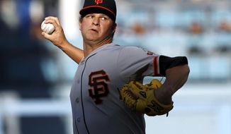 San Francisco Giants starting pitcher Matt Cain throws against the Los Angeles Dodgers in the first inning of a baseball game Sunday, April 6, 2014, in Los Angeles. (AP Photo/Alex Gallardo)