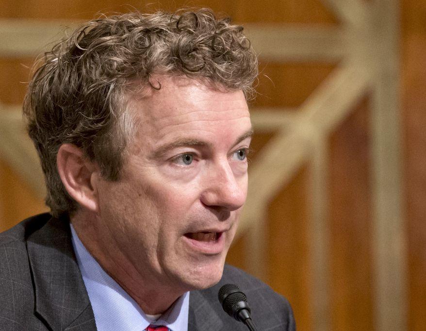 ** FILE ** In this Nov. 6, 2013, file photo, Sen. Rand Paul, R-Ky., speaks on Capitol Hill in Washington.  (AP Photo/J. Scott Applewhite, File)