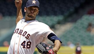 Houston Astros' Jarred Cosart delivers a pitch against the Los Angeles Angels in the first inning of a baseball game Monday, April 7, 2014, in Houston. (AP Photo/Pat Sullivan)