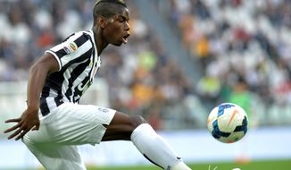 Juventus midfielder Paul Pogba, of France, controls the ball during a Serie A soccer match between Juventus and Livorno at the Juventus stadium, in Turin, Italy, Monday, April 7, 2014. (AP Photo/Massimo Pinca)