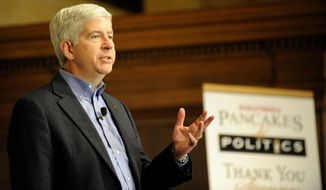 "Gov. Rick Snyder speaks at the ""Pancakes and Politics""  event on Monday, April 7, 2014 in Detroit.  Snyder plans to talk about Detroit's turnaround. He hired emergency manager Kevyn Orr a year ago and authorized him to take the city into bankruptcy court last summer. Orr hopes Detroit can exit bankruptcy by October. (AP Photo/Detroit News, David Coates)  DETROIT FREE PRESS OUT; HUFFINGTON POST OUT"