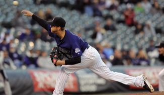 Colorado Rockies starting pitcher Jordan Lyles throws in the first inning of a baseball game against the Chicago White Sox on Monday, April 7, 2014, in Denver.(AP Photo/Chris Schneider)