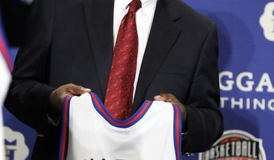 Former Arkansas coach Nolan Richardson stands on stage during the Naismith Memorial Basketball Hall of Fame class of 2014 announcement, Monday, April 7, 2014, in Dallas. (AP Photo/Charlie Neibergall)