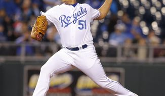 Kansas City Royals starting pitcher Jason Vargas delivers to a Tampa Bay Rays batter during the third inning of the MLB American League baseball game at Kauffman Stadium in Kansas City, Mo., Monday, April 7, 2014. (AP Photo/Orlin Wagner)