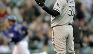 Chicago White Sox starting pitcher Felipe Paulino stands in the infield as Colorado Rockies Carlos Gonzalez rounds the bases after hitting a home run in the first inning of a baseball game on Monday, April 7, 2014, in Denver.(AP Photo/Chris Schneider)