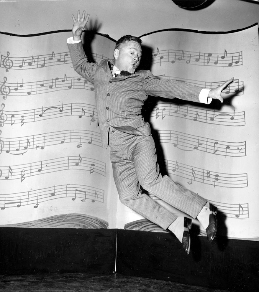"FILE - In this March 19, 1957, file photo, actor, singer and dancer Mickey Rooney, wearing spats and a pinstriped suit, performs a dance routine during rehearsal for the television show ""George M. Cohan Story"" in Hollywood, Calif. Rooney, a Hollywood legend whose career spanned more than 80 years, has died. He was 93. Los Angeles Police Commander Andrew Smith said that Rooney was with his family when he died Sunday, April 6, 2014, at his North Hollywood home. (AP Photo/File)"