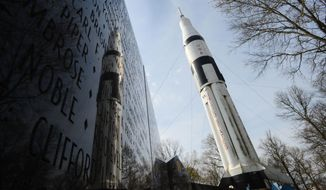 This April 2, 2014 photo shows the Saturn 1B Rocket at the Alabama Welcome Center on Interstate 65 on April 2, 2014 in Ardmore, Ala.  The paint is faded, and black mold and algae cover the bottom. Birds use the rocket's crevices for nests, and their droppings are everywhere. The U.S. Space and Rocket Center in Huntsville is working with the Alabama Department of Transportation to get it pressure-washed and painted this summer. The state Tourism Department will fund the project. (AP Photo/The Decatur Daily, Gary Cosby Jr.)