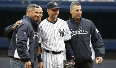 "Members of the Yankees ""Core Four,"" from left, former Yankees catcher Jorge Posada, reliever Mariano Rivera, New York Yankees shortstop Derek Jeter, and former Yankees starting pitcher Andy Pettitte pose together after Rivera and Pettitte threw out the ceremonial first pitch to Jeter and Posada before a baseball game against the Baltimore Orioles, at Yankee Stadium in New York, Monday, April 7, 2014.  (AP Photo/Kathy Willens)"