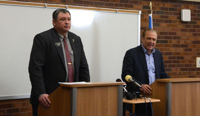 State Rep. Stace Nelson, left, a Republican candidate for U.S. Senate, and Democratic candidate Rick Weiland speak at a joint news conference, Monday, April 7, 2014, in Sioux Falls, S.D. The candidates criticized former Gov. Mike Rounds, the Republican frontrunner in the race, for his millions of dollars raised from out-of-state sources. (AP Photo/Dirk Lammers)