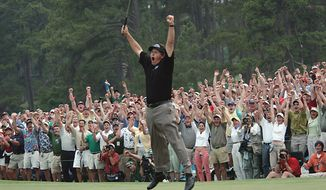 Phil Mickelson celebrates after winning the Masters golf tournament at the Augusta National Golf Club in Augusta, Ga., in this April 11, 2004 file photo. (AP Photo/Dave Martin)