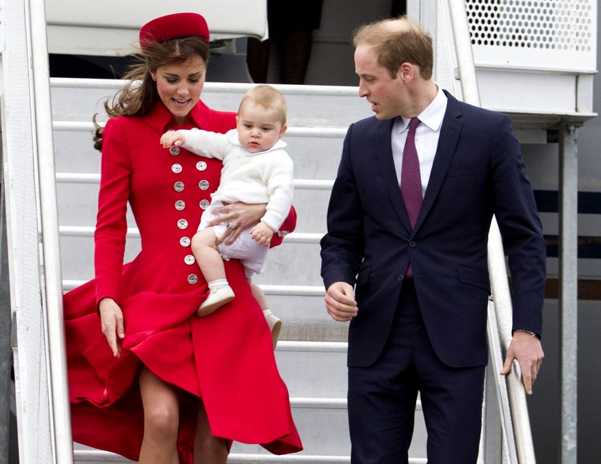 Britain's Prince William and his wife Kate, the Duchess of Cambridge with Prince George arrive for their visit to New Zealand at the International Airport, in Wellington, New Zealand, Monday, April 7, 2014. (AP Photo/SNPA, David Rowland) NEW ZEALAND OUT