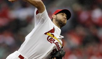 St. Louis Cardinals starting pitcher Michael Wacha throws during the first inning of a baseball game against the Cincinnati Reds, Monday, April 7, 2014, in St. Louis. (AP Photo/Jeff Roberson)