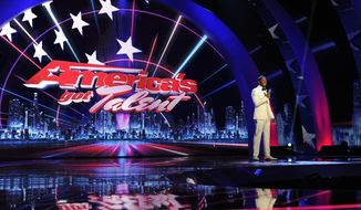"""FILE - This Sept. 14, 2012, file photo, provided by NBC shows host Nick Cannon on stage during auditions for the talent competition series """"America's Got Talent,"""" in Newark, N.J. The producers of the """"Got Talent"""" franchise say the TV talent contest is a winner in its own right. Syco Entertainment and FremantleMedia said Monday, April 7, 2014, that Guinness World Records has deemed the series the most successful reality TV format worldwide. (AP Photo/NBC, Virginia Sherwood, File)"""
