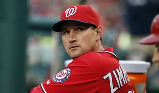 Washington Nationals third baseman Ryan Zimmerman (11) pauses in the dugout during a baseball game against the Atlanta Braves at Nationals Park Saturday, April 5, 2014, in Washington. (AP Photo/Alex Brandon)