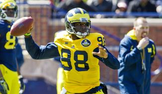 Michigan quarterback Devin Gardner (98) throws a pass during the NCAA college football team's annual spring game on Saturday, April 5, 2014, in Ann Arbor, Mich. (AP Photo/Tony Ding)