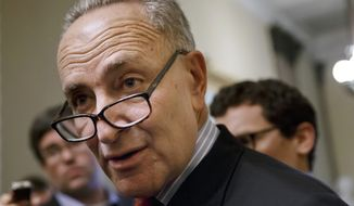 ** FILE ** In this March 26, 2014, file photo, Sen. Charles Schumer, D-N.Y., speaks on Capitol Hill in Washington. (AP Photo/J. Scott Applewhite, File)