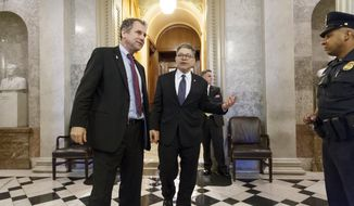 ** FILE ** Sen. Sherrod Brown, D-Ohio, left, and Sen. Al Franken, D-Minn., leave the chamber during the vote on restoring jobless benefits for the long-term unemployed, legislation that expired late last year, at the Capitol in Washington, Monday, April 7, 2014. (AP Photo/J. Scott Applewhite)