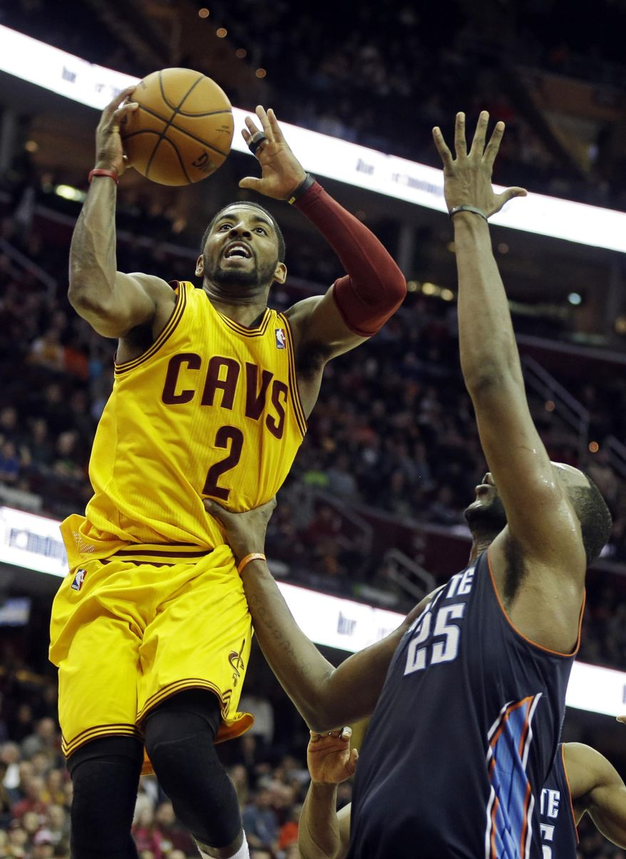 Cleveland Cavaliers' Kyrie Irving (2) shoots against Charlotte Bobcats' Al Jefferson in overtime of an NBA basketball game on Saturday, April 5, 2014, in Cleveland. Irving scored a career-high 44 points but the Cavaliers lost to Charlotte 96-94. (AP Photo/Mark Duncan)