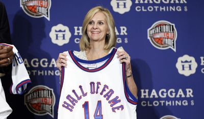 Former player Judy Martelli, representing Immaculata University, stands on stage during the Naismith Memorial Basketball Hall of Fame class of 2014 announcement, Monday, April 7, 2014, in Dallas. (AP Photo/Charlie Neibergall)
