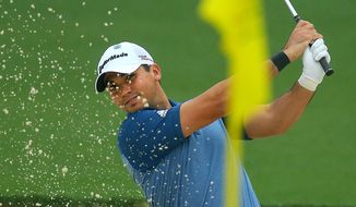 Jason Day, of Australia, hits from a sand trap to the 17th green during practice for the Masters golf tournament Monday, April 7, 2014 in Augusta, Ga. (AP Photo/Atlanta Journal-Constitution, Curtis Compton)  MARIETTA DAILY OUT; GWINNETT DAILY POST OUT; LOCAL TV OUT; WXIA-TV OUT; WGCL-TV OUT