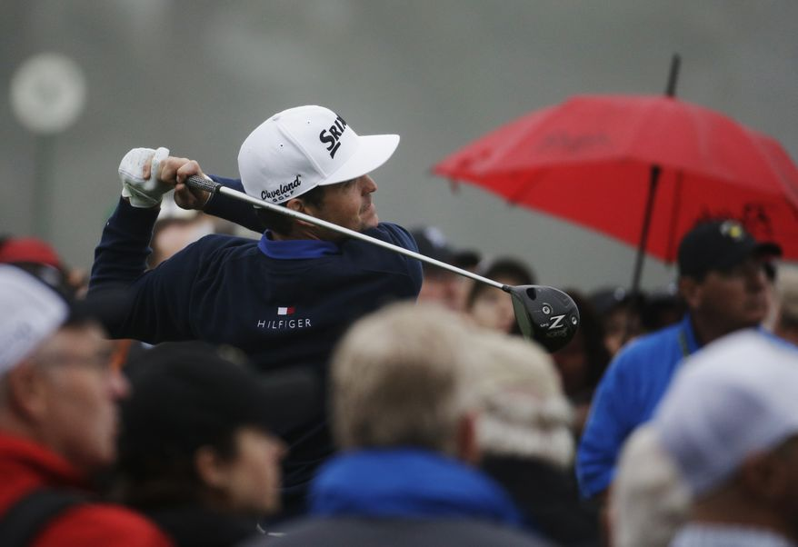 Keegan Bradley watches his tee shot on the first hole during a practice session for the Masters golf tournament Monday, April 7, 2014, in Augusta, Ga. (AP Photo/Darron Cummings)