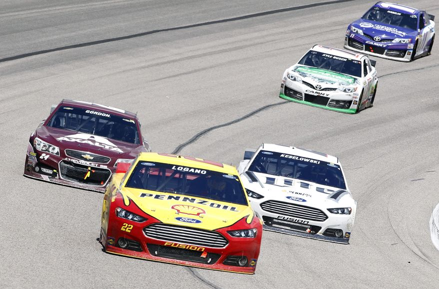 Sprint Cup Series driver Joey Logano (22) leads Brad Keselowski (2), Jeff Gordon (24), Kyle Busch (18) and Denny Hamlin (11) around Turn 4 during the NASCAR Sprint Cup Series auto race at Texas Motor Speedway, Monday, April 7, 2014, in Fort Worth, Texas. (AP Photo/Mike Stone)