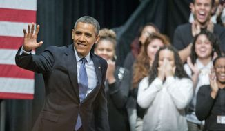 President Barack Obama waves as he is introduced before speaking at Bladensburg High School in Bladensburg, Md., Monday, April 7, 2014, about the economy and to announce the winners of a competition he launched last fall to bring together educators and employers to redesign the high school experience to give students access to real-world career skills and college-level courses. (AP Photo/Pablo Martinez Monsivais)