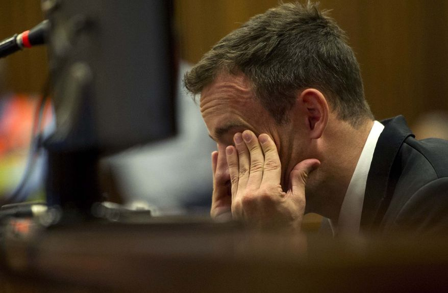 Oscar Pistorius reacts as he listens to evidence by a pathologist in court in Pretoria, South Africa, Monday, April 7, 2014. A pathologist called as the first defense witness in the Oscar Pistorius murder trial offered a different sequence for the shots that killed Reeva Steenkamp and also testified Monday that if the double-amputee athlete fired his 9 mmm pistol in two quick bursts, as Pistorius claims he did, his girlfriend probably didn't have time to scream.  Pistorius is charged with murder  for the shooting death of his girlfriend Reeva Steenkamp, on Valentines Day 2013. (AP Photo/Deaan Vivier, Pool)