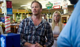 """This photo released by Syfy shows Ian Ziering, left, as Fin, Tara Reid as April in a scene from the Syfy original movie, """"Sharknado."""" """"Sharknado 2: The Second One"""" will take a bite out of New York City on July 30, 2014, in Syfy's sequel to the campy classic that aired last summer.  (AP Photo/Syfy)"""