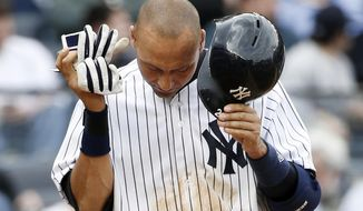 New York Yankees Derek Jeter reacts after striking out on a foul tip with two runners on base in the sixth inning of a baseball game against the Baltimore Orioles at Yankee Stadium in New York, Tuesday, April 8, 2014.  (AP Photo/Kathy Willens)