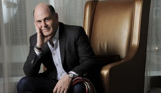 "FILE - In this Sept. 7, 2013 file photo, ""Mad Men"" creator Matthew Weiner poses for a portrait on day 3 of the 2013 Toronto International Film Festival in Toronto. Weiner, as the auteur of the landmark drama series, voices both resolve and wonderment at his task of bringing ""Mad Men"" in for a landing. His goal, he says, is not to wallop the audience with a grand parting shot, but something more gently profound: ""to leave the characters in a place where they're going to be in viewers' imaginations forever.""  (Photo by Chris Pizzello/Invision/AP, File)"