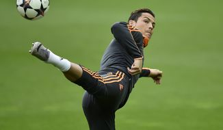 Real's Christiano Ronaldo exercises during the training session prior the UEFA Champions League second leg soccer match between Borussia Dortmund and Real Madrid in Dortmund, Monday, April 7, 2014. Ronaldo had to break off the training. (AP Photo/Martin Meissner)