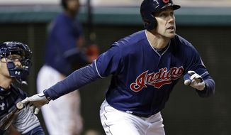 Cleveland Indians' David Murphy watches his three-run home run off San Diego Padres starting pitcher Tyson Ross in the fourth inning of the MLB baseball game Tuesday, April 8, 2014, in Cleveland. (AP Photo/Mark Duncan)