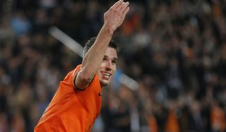 FILE - In this Oct. 11, 2013, file photo, Netherlands' Robin van Persie celebrates scoring 4-1 during the Group D World Cup qualifying soccer match between Netherlands and Hungary, in Amsterdam, Netherlands. Robin van Persie and Arjen Robben continue to spark the Oranje, but Van Persie must seize the opportunity after the Manchester United striker has scored only once at the last two major tournaments, the 2010 World Cup and Euro 2012. (AP Photo/Peter Dejong, File)