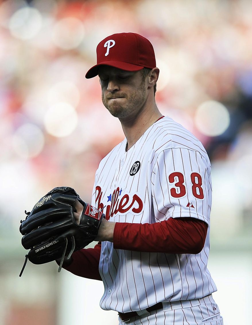 Philadelphia Phillies starting pitcher Kyle Kendrick reacts after giving up a three-run home run to Milwaukee Brewers' Ryan Braun in the third inning of a baseball game Tuesday, April 8, 2014, in Philadelphia. (AP Photo/Michael Perez)