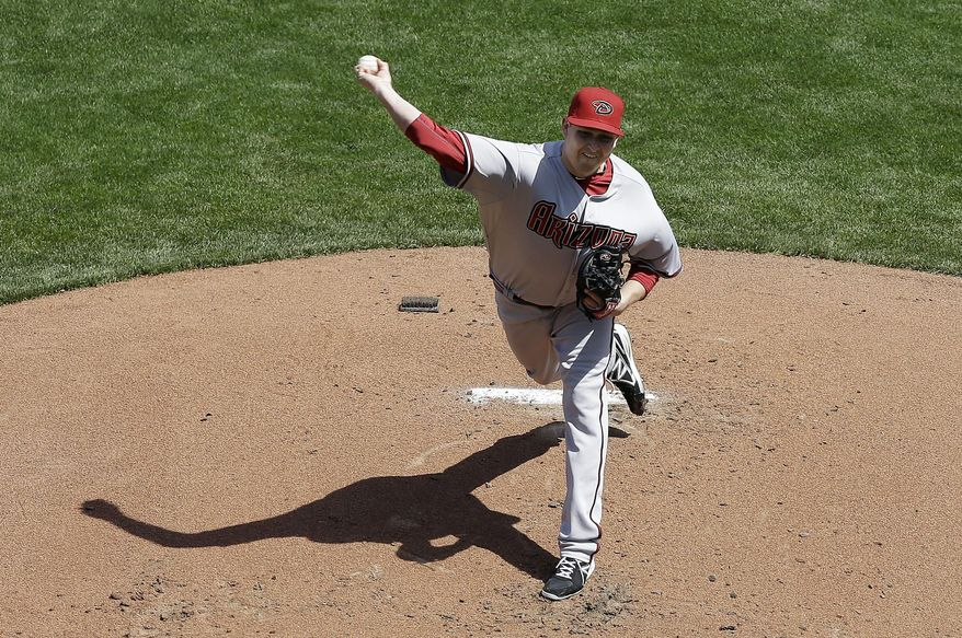 Arizona Diamondbacks pitcher Trevor Cahill throws against the San Francisco Giants during the first inning of an opening day baseball game in San Francisco, Tuesday, April 8, 2014. (AP Photo/Jeff Chiu)