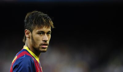 FC Barcelona's Neymar looks on during a Spanish La Liga soccer match against Betis at the Camp Nou stadium in Barcelona, Spain, Saturday, April 5, 2014. (AP Photo/Manu Fernandez)
