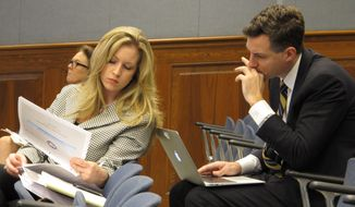 Erin Bendily, assistant superintendent with the Department of Education, and Louisiana Superintendent of Education John White review budget information provided to the House Appropriations Committee on Tuesday, April 8, 2014, in Baton Rouge, La. (AP Photo/Melinda Deslatte)