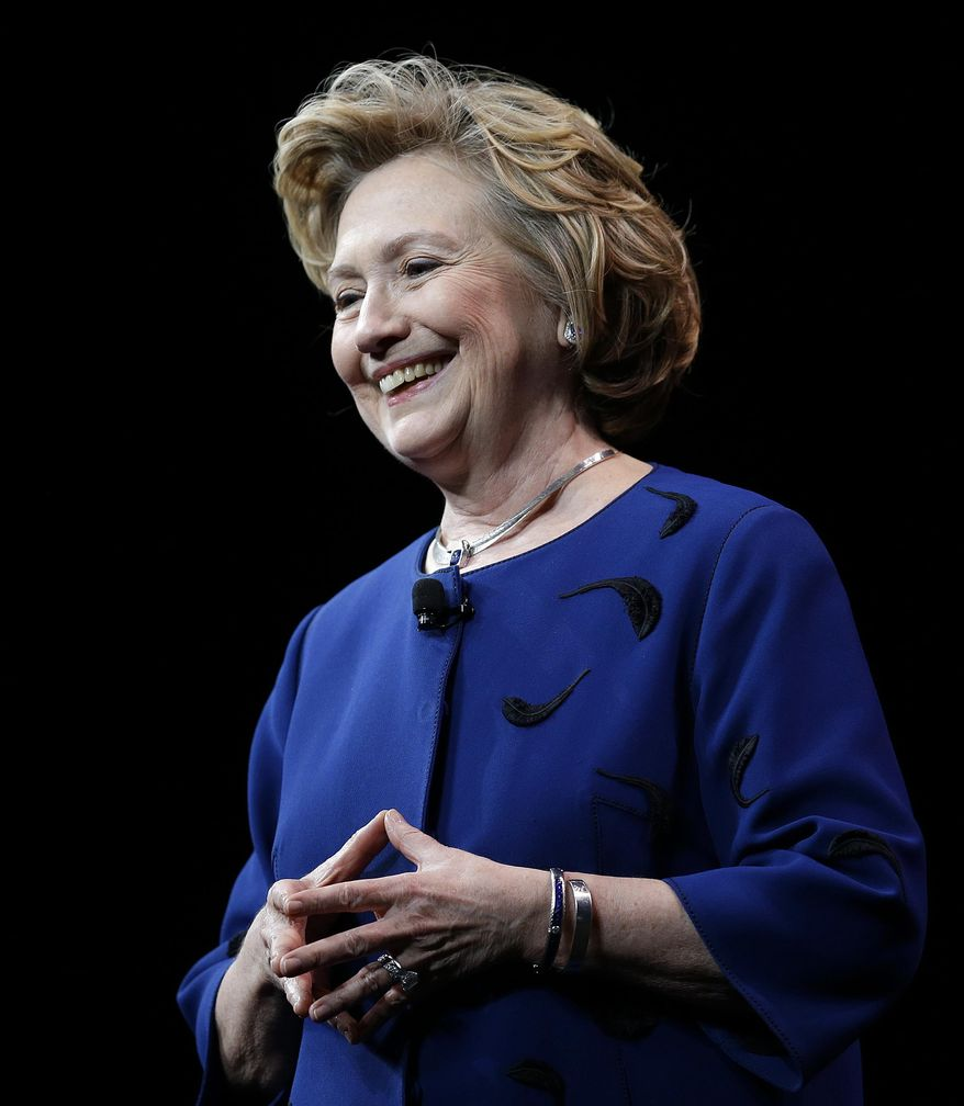 Former Secretary of State Hillary Rodham Clinton smiles while delivering the keynote address at Marketo's 2014 Marketing Nation Summit Tuesday, April 8, 2014, in San Francisco. (AP Photo/Ben Margot)