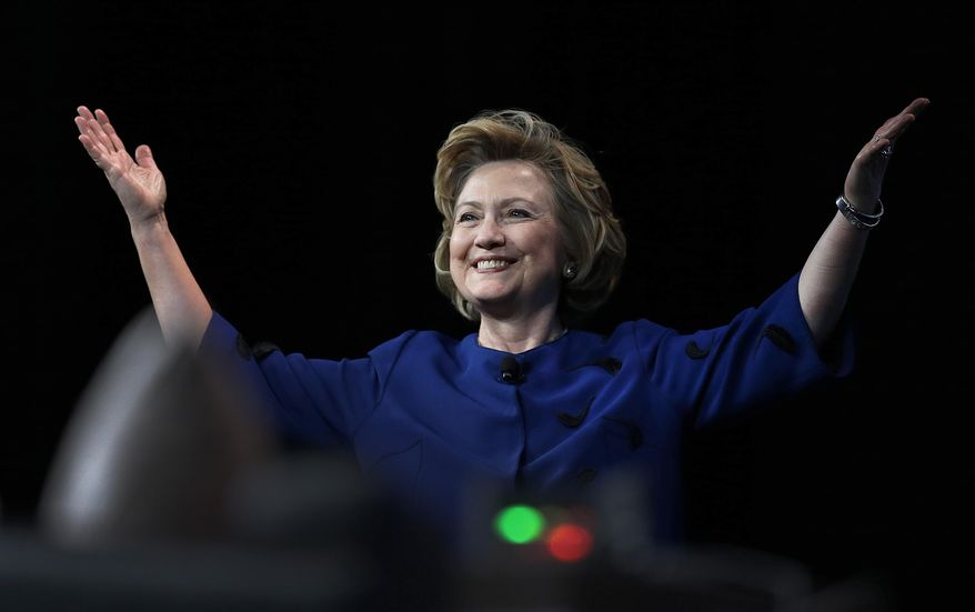 Former Secretary of State Hillary Rodham Clinton gestures before delivering the keynote address at Marketo's 2014 Marketing Nation Summit Tuesday, April 8, 2014, in San Francisco. (AP Photo/Ben Margot)