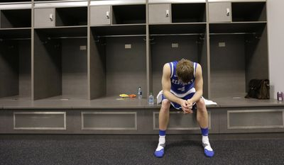 Kentucky guard Jon Hood sits in the locker room after his team's 60-54 loss to Connecticut in the NCAA Final Four tournament college basketball championship game Monday, April 7, 2014, in Arlington, Texas. (AP Photo/Eric Gay)