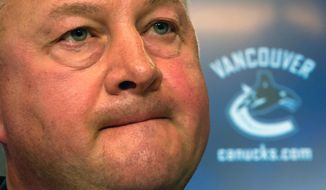 FILE - In this May 22, 2013 file photo, Vancouver Canucks president and general manager Mike Gillis addresses reporters in Vancouver, British Columbia. The Canucks have fired Gillis, Tuesday, April 8, 2014,  a day after being eliminated from playoff contention. (AP Photo/The Canadian Press, Darryl Dyck, File)