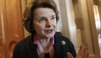 FILE - This March 27, 2014, file photo shows Senate Intelligence Committee Chair Sen. Dianne Feinstein, D-Calif. speaking on Capitol Hill in Washington. Feinstein is appealing to President Barack Obama to remove the CIA from declassifying a torture report harshly critical of the agency's actions. In a letter to the president, Feinstein says the White House should lead the editing process. Feinstein's Senate Intelligence Committee voted last week to release parts of the 6,600-page review after information compromising national security is blacked out. Obama has backed the declassification. But the White House has said the CIA will lead that process. (AP Photo/J. Scott Applewhite, File)