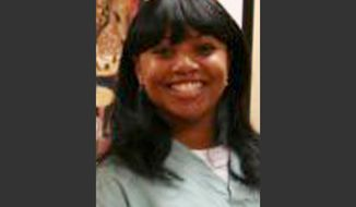 FILE - This 2011 file photo provided by Dr. Barry Weiss, from the website of Advanced Periodontics in Hamden, Conn., shows former employee Miriam Carey. Carey was shot to death after a car chase in October 2013 that went from the White House to near the U.S. Capitol. The attorney for Carey's family says her autopsy finds that she was shot multiple times from behind, including a shot to the back of the head. (AP Photo/Advanced Periodontics, File)
