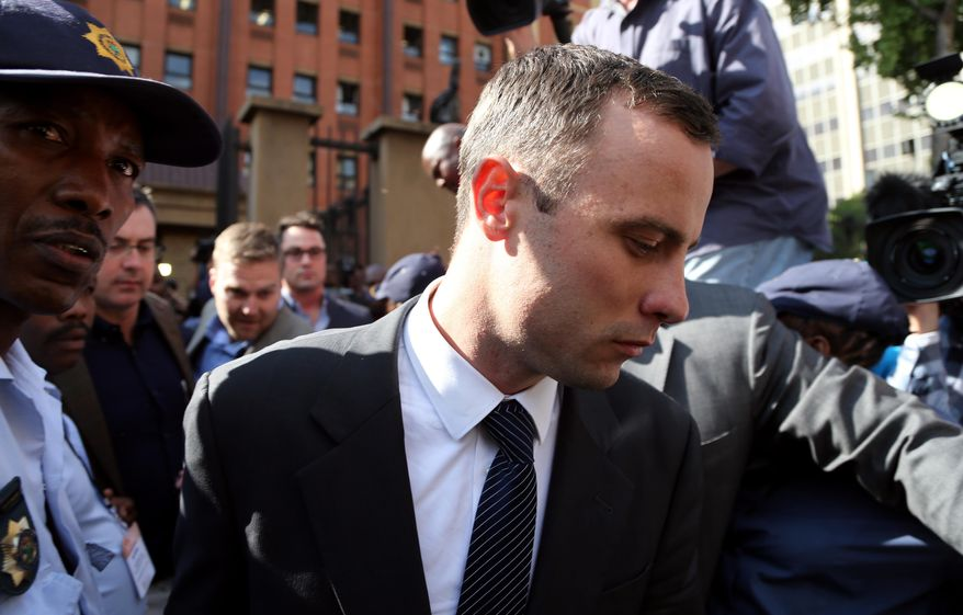 Oscar Pistorius, leaves the high court in Pretoria, South Africa, Tuesday, April 8, 2014. Pistorius is charged with murder for the shooting death of his girlfriend, Reeva Steenkamp, on Valentines Day in 2013. (AP Photo/Themba Hadebe)